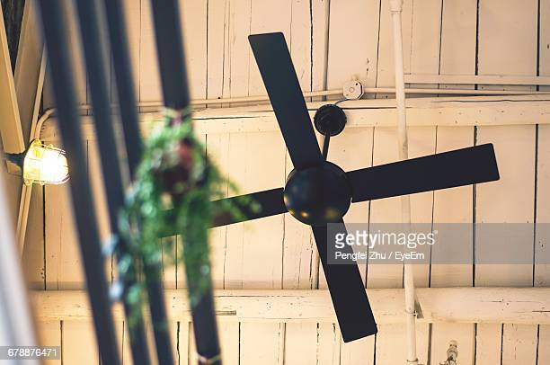 Low Angle View Of Black Ceiling Fan