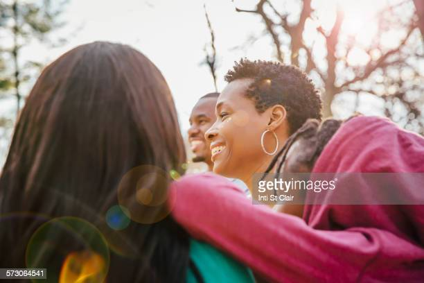 Low angle view of Black family smiling outdoors