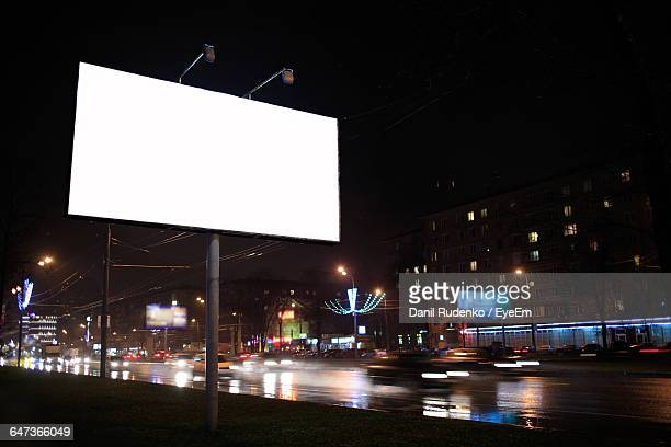 Low Angle View Of Blank Billboard By Street Against Sky At Night