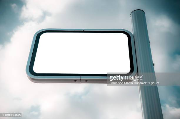 low angle view of blank signboard against sky - martin stange stock-fotos und bilder