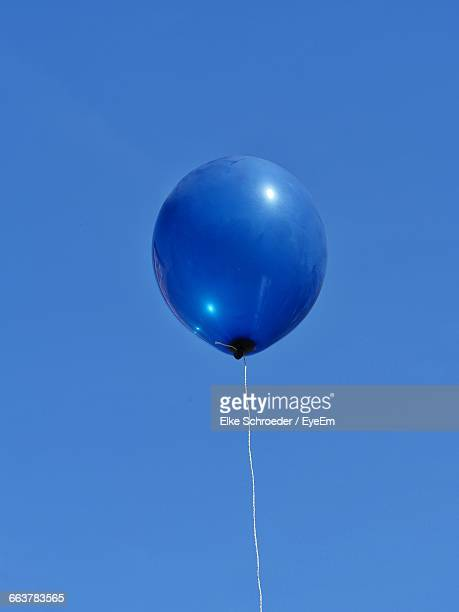 Low Angle View Of Blue Helium Balloon Against Clear Sky