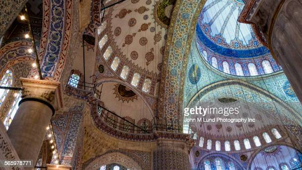 Low angle view of Blue Mosque domes and mosaic, Istanbul, Turkey