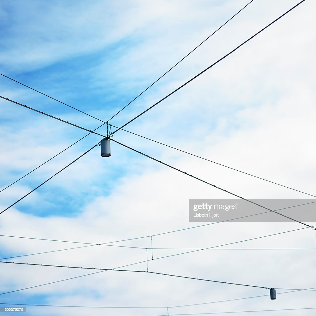 Low Angle View Of Blue Sky And Street Lights With Criss ... on