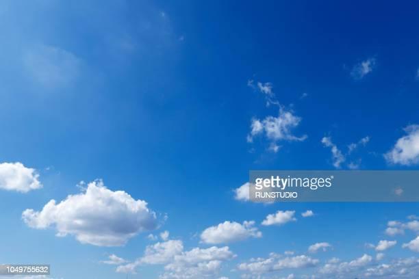 low angle view of blue sky - 雲 ストックフォトと画像