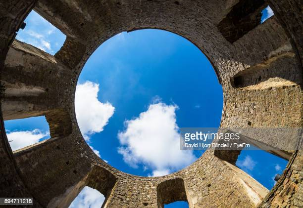 low angle view of blue sky seen through castle - ancient civilization stock photos and pictures