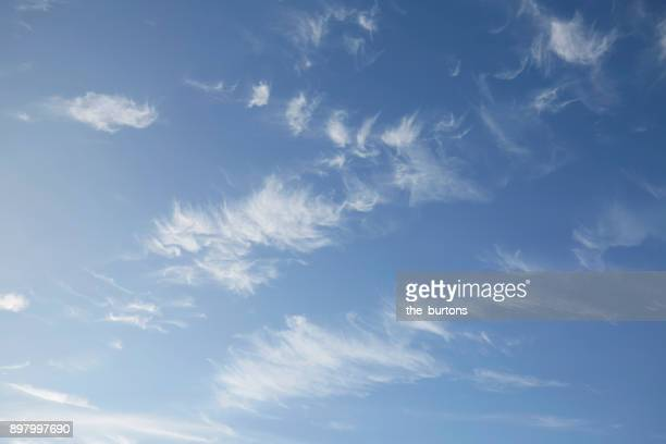 Low angle view of blue sky with clouds, full frame shot