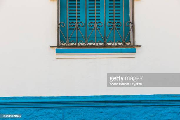 Low Angle View Of Blue Window Of Building