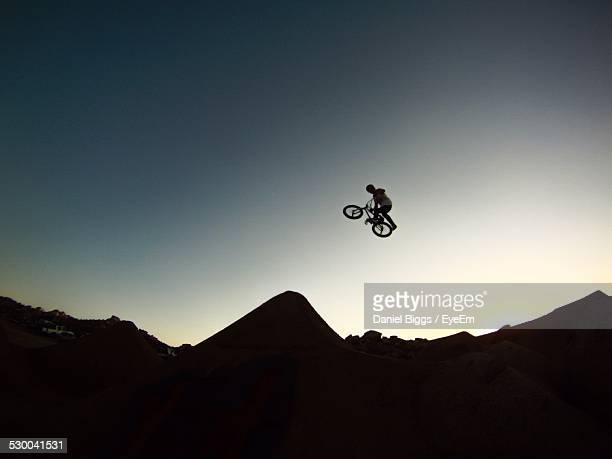 Low Angle View Of Bmx Biker Against Blue Sky