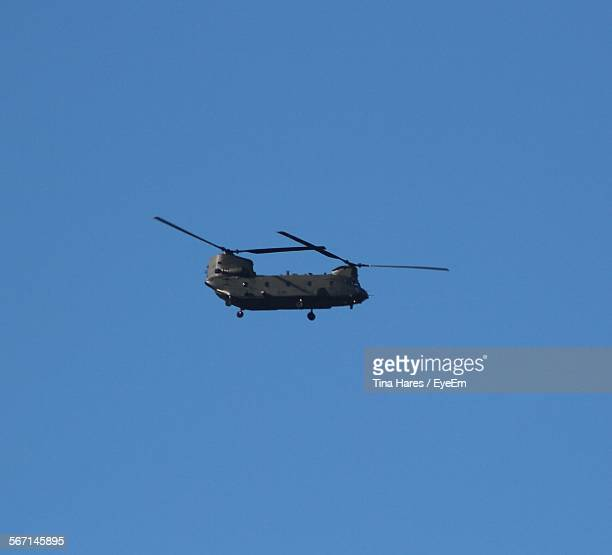 Low Angle View Of Boeing Ch-47 Chinook Flying Clear Blue Sky