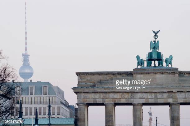 Low Angle View Of Brandenburg Gate And Fernsehturm Against Clear Sky