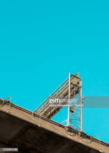 low angle view of bridge against against clear blue sky - apisit hiranpornpan stock pictures, royalty-free photos & images