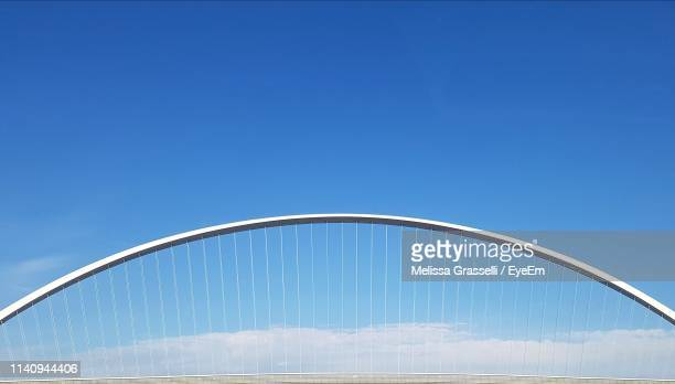 low angle view of bridge against blue sky - reggio emilia stock pictures, royalty-free photos & images