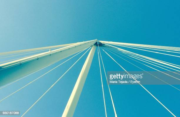 low angle view of bridge against clear blue sky - maria tejada stock pictures, royalty-free photos & images