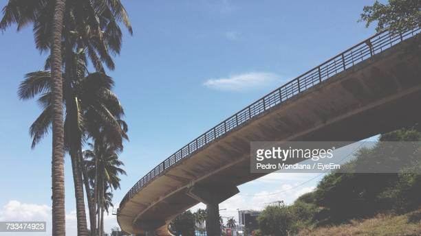 low angle view of bridge against cloudy sky - maputo city stock pictures, royalty-free photos & images