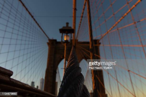 low angle view of bridge against sky during sunset - haack stock pictures, royalty-free photos & images