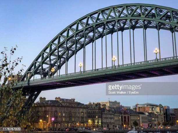 low angle view of bridge against sky in city - newcastle upon tyne stock-fotos und bilder