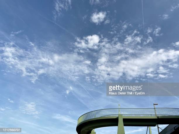 low angle view of bridge against sky on sunny day - klaus-dieter thill stock-fotos und bilder