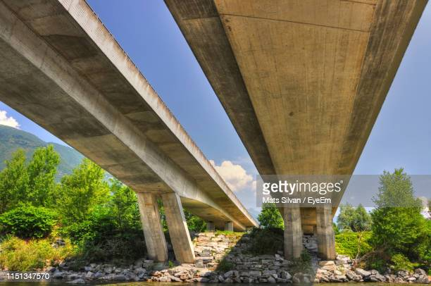 low angle view of bridge against sky - man made structure stock pictures, royalty-free photos & images
