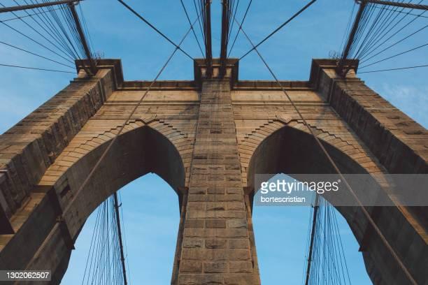 low angle view of bridge against sky - bortes foto e immagini stock