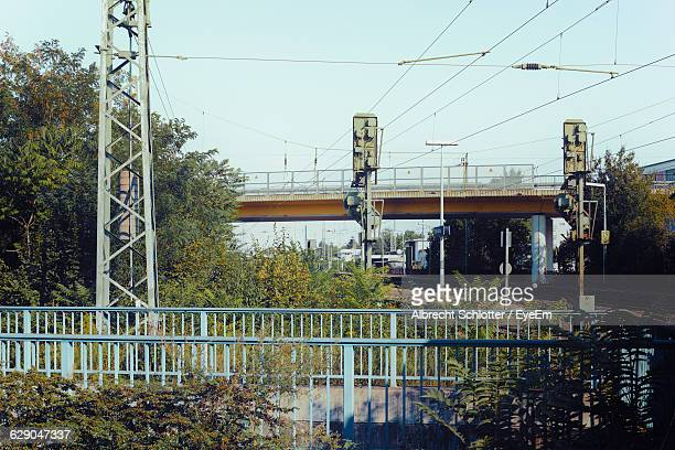 low angle view of bridge against sky - albrecht schlotter stock photos and pictures