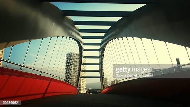 low angle view of bridge and building in city against sky - zürich stock-fotos und bilder