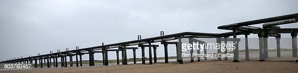 low angle view of bridge at beach - port talbot stock pictures, royalty-free photos & images