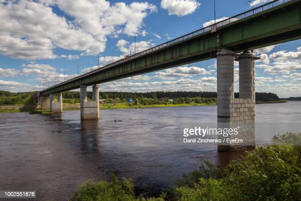 low angle view of bridge over river against sky - zinchenko stock pictures, royalty-free photos & images