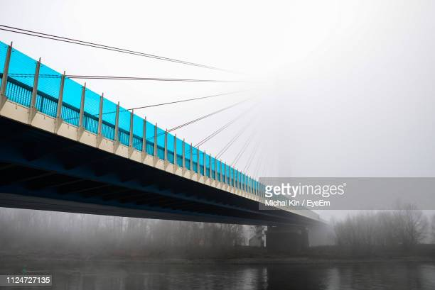 low angle view of bridge over river against sky - コブレンツ ストックフォトと画像