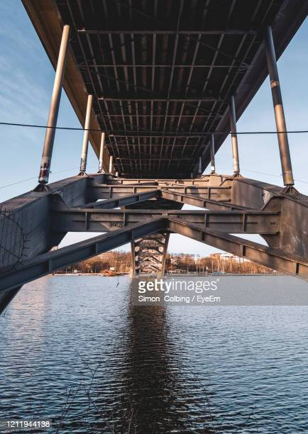 low angle view of bridge over river against sky - colbing stock pictures, royalty-free photos & images