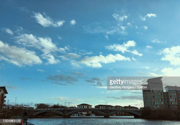 low angle view of bridge over river by buildings against sky - stockton on tees stock pictures, royalty-free photos & images