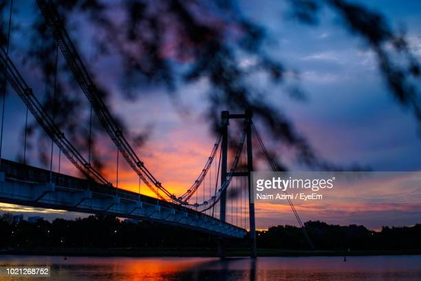 low angle view of bridge over river during sunset - putrajaya stock pictures, royalty-free photos & images