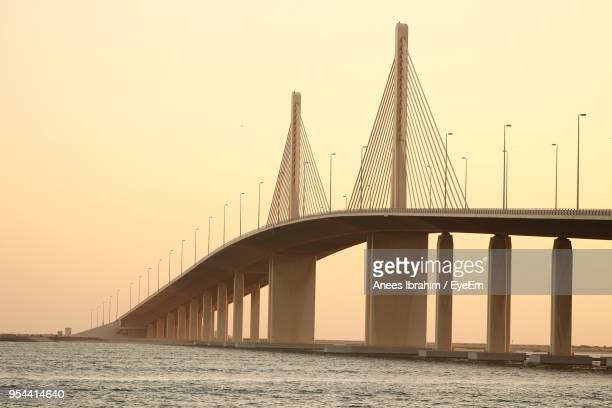 low angle view of bridge over sea against clear sky - abu dhabi stock pictures, royalty-free photos & images