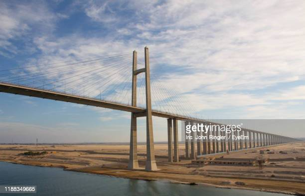 low angle view of bridge over sea against sky - suez canal stock pictures, royalty-free photos & images