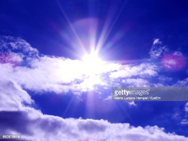 low angle view of bright sun in sky - elysium stock photos and pictures