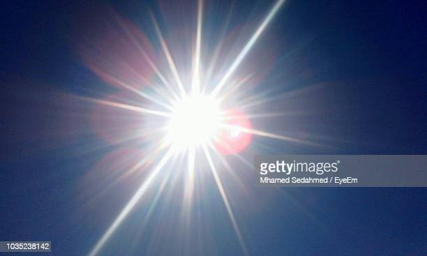 low angle view of bright sun - solar flare stock pictures, royalty-free photos & images