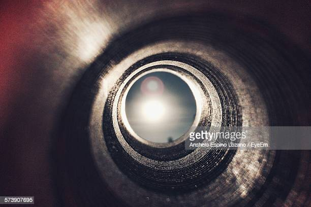 Low Angle View Of Bright Sun Seen Through Pipe