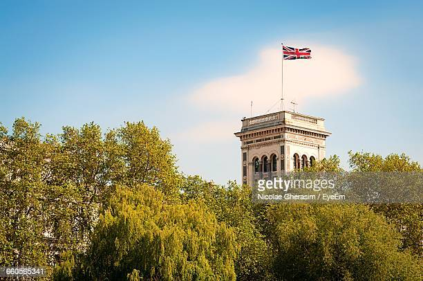 Low Angle View Of British Flag Waving On Government Building