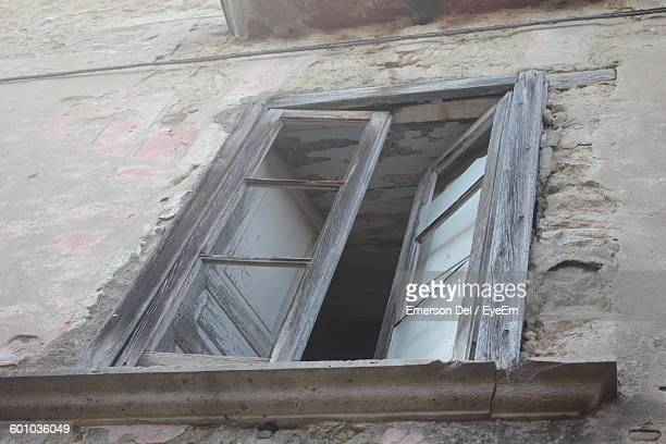 Low Angle View Of Broken Abandoned House Window