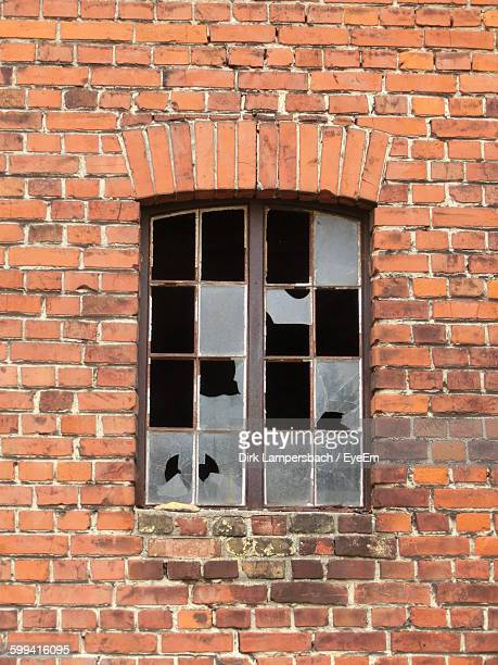 Low Angle View Of Broken Window Of Old Building