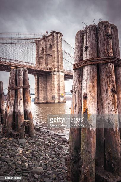low angle view of brooklyn bridge, new york city, usa - international landmark stock pictures, royalty-free photos & images