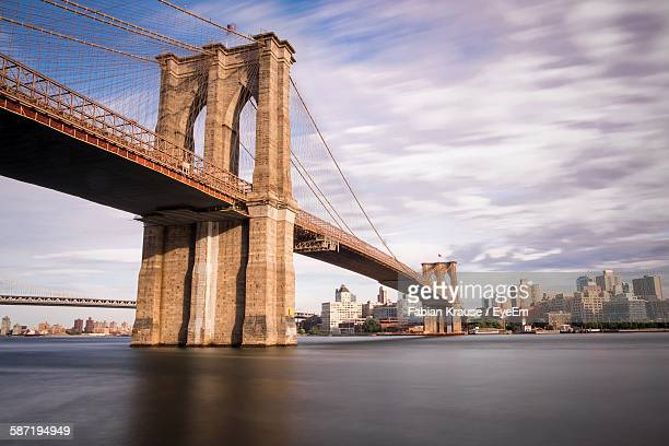 low angle view of brooklyn bridge - brooklyn bridge stock pictures, royalty-free photos & images