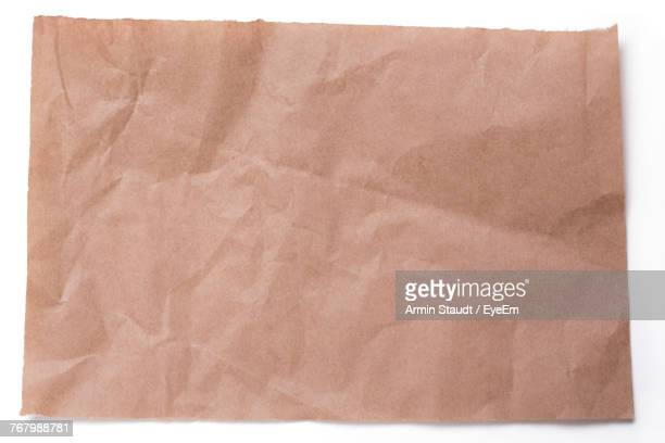 Low Angle View Of Brown Paper Over White Background