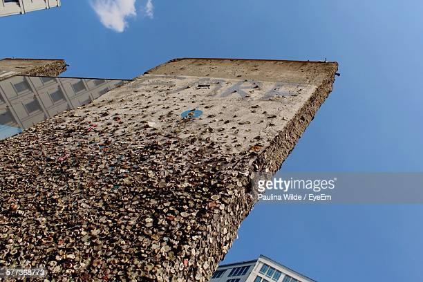 Low Angle View Of Bubble Gums On Berlin Wall Against Clear Sky