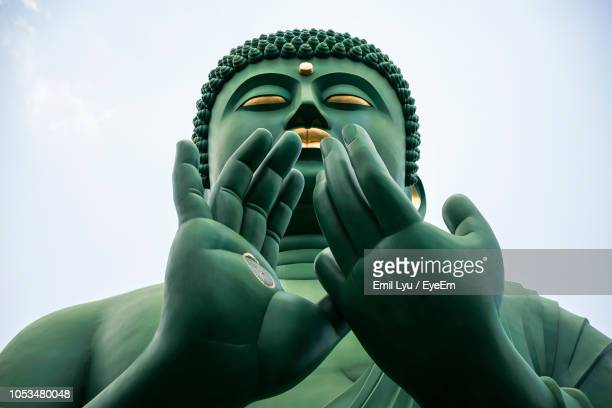 low angle view of buddha statue against clear sky - nagoya stock pictures, royalty-free photos & images