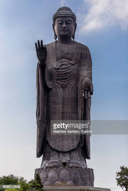 low angle view of buddha statue against sky - 像 ストックフォトと画像