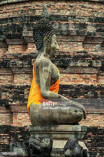 Low Angle View Of Buddha Statue At Temple