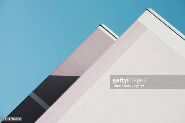low angle view of building against blue sky - architecture stock pictures, royalty-free photos & images