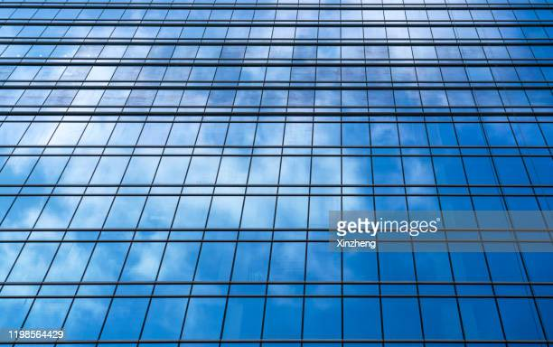 low angle view of building against blue sky - 角度 ストックフォトと画像