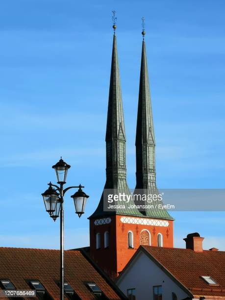 low angle view of building against blue sky - vaxjo stock pictures, royalty-free photos & images