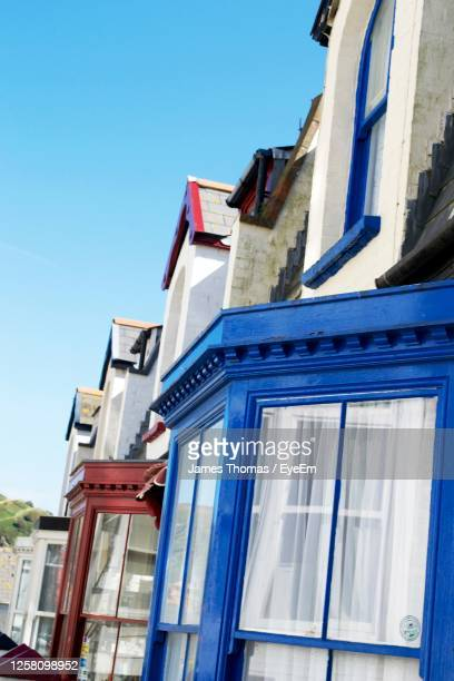 low angle view of building against blue sky - ilfracombe stock pictures, royalty-free photos & images